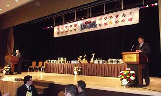 2012 season QMFL banquet front stage with MCs and trophies